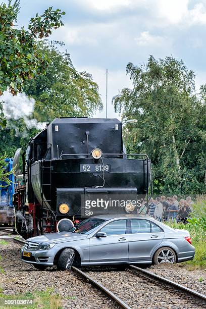 Steam locomotive and Mercedes passenger car collision