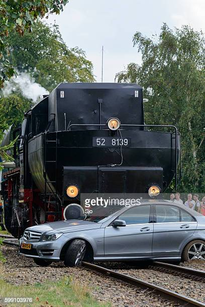 Steam locomotive and Mercedes passenger car collision
