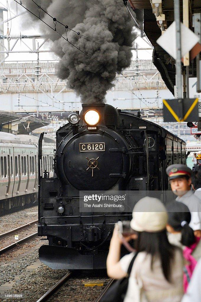 Steam Locomotive 'Fukushima Fukko Go'. depart at Koriyama Station on July 25, 2012 in Koriyama, Fukushima, Japan.