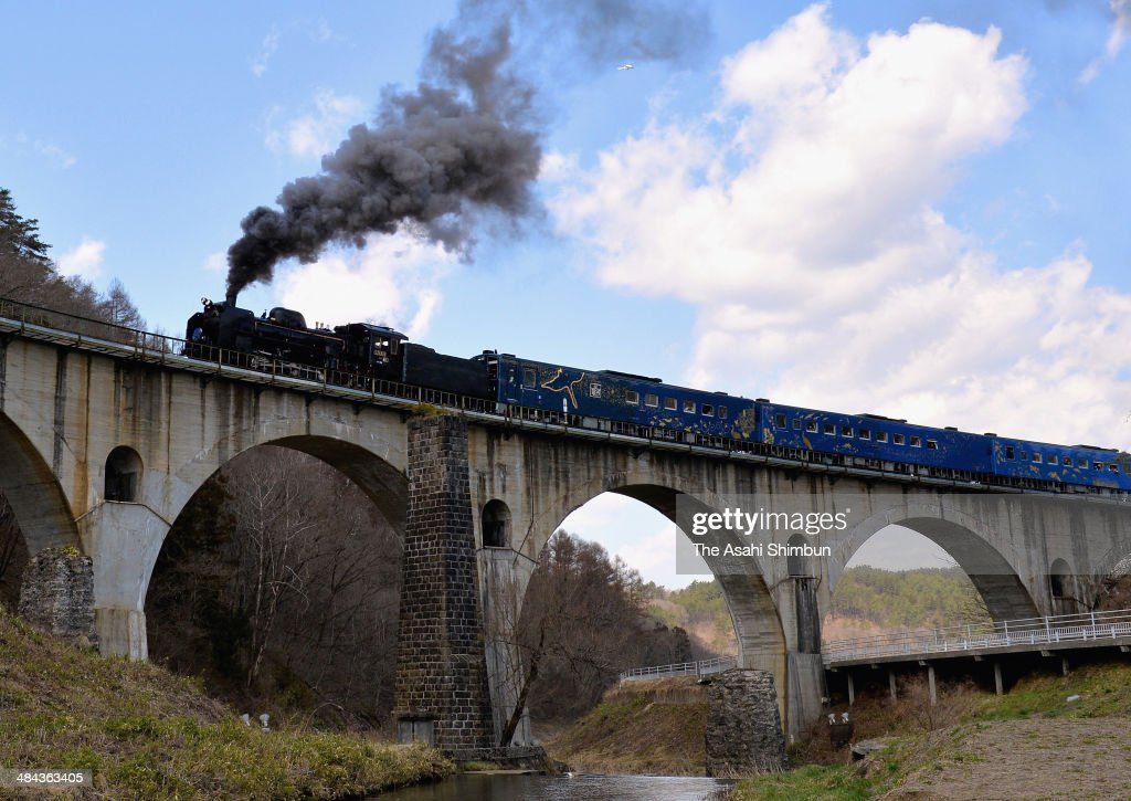 Steam locomotive 'Ginga (Galaxy)' runs over the Miyamori River Bridge on April 12, 2014 in Tono, Iwate, Japan. The train, named after the novel 'Night on the Galactic Railroad' by local novelist Kenji Miyazawa, operate on weekends, as a part of JR East's restoration support project of the tsunami devastated Tohoku area.