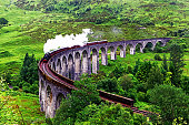 Steam locomotive on the famous Glenfinnan Viaduct in Scotland