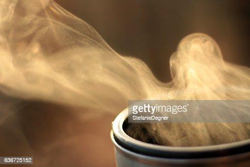 Steam of hot tea against sun in nature, Evaporation : Stock Photo