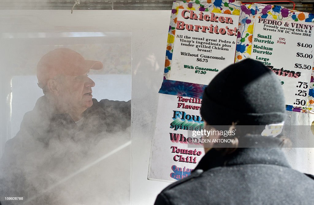 Steam pours out from a Mexican Burrito vendor's lunch wagon on a street in Washington, DC, on January 23, 2013. Two-thirds of the US was in the grips of a blast of cold Arctic air Wednesday with temperatures falling to some of the lowest marks in years and wind chills plummeting to dangerously low levels.