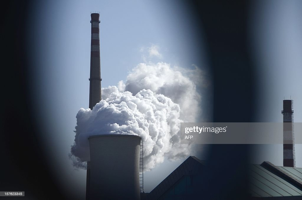 Steam rises from a power station in Beijing on December 5, 2012. Manufacturing activity in China hit a 13-month high in November, HSBC said on December 3, in another sign that the world's second largest economy is emerging from a drawn-out slumber. AFP PHOTO/WANG ZHAO