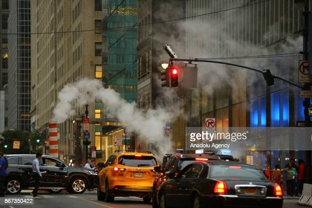 Steam rises from a vent in New York City New York USA on October 28 2017 It is a district heating system which takes steam produced by steam...