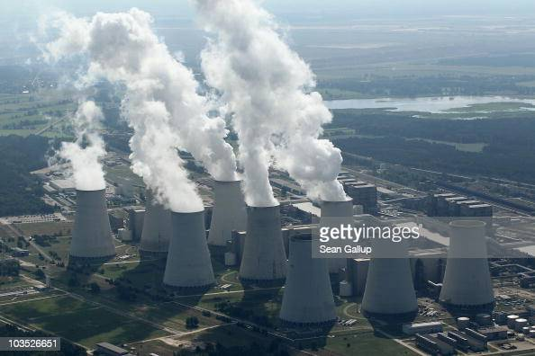 Steam rises from cooling towers at the Jaenschwalde coalfired power plant on August 20 2010 at Jaenschwalde Germany The Jaenschwalde power plant is...