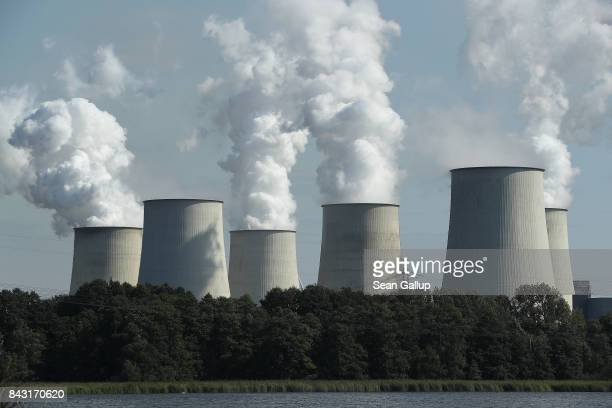 Steam rises from cooling towers at the Jaenschwalde coalfired power plant on September 5 2017 near Peitz Germany Germany is making strong progress in...