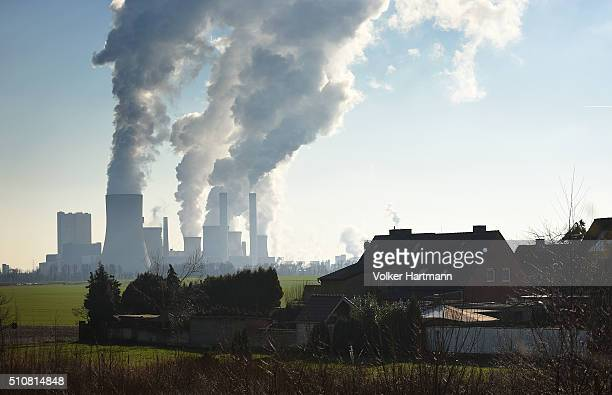 Steam rises from cooling towers at the RWE Niederaussem coalfired power plant on February 16 2016 near Bergheim Germany Germany is maintaining...