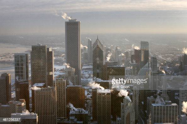 Steam rises from downtown buildings as temperature begin to climb above zero for the first time in more than 30 hours on January 7 2014 in Chicago...