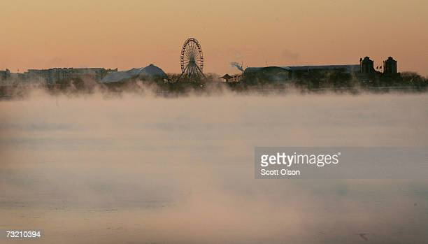 Steam rises from Lake Michigan as the sun comes up over Navy Pier during a subzero morning February 5 2007 in Chicago Illinois Temperatures were not...