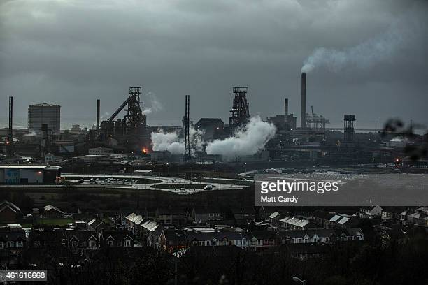 Steam rises from the blast furnaces at the Tata owned steel works on January 15 2015 in Port Talbot Wales Along with health and education...