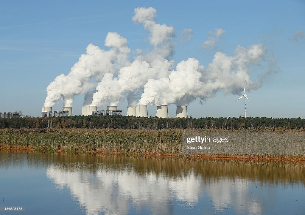 Steam rises from the cooling towers of the Jaenschwalde coal-fired power plant on October 31, 2013 near Jaenschwalde, Germany. The Jaenschwalde plant is fed with lignite coal from nearby open-pit mines, and according to plans by Swedish energy conglomerate Vattenfall and approved by the Brandenburg state legislature, at least five local communities are to be raized and their inhabitants compensated and relocated in order to make way for the expansion of a nearby mine. Energy policy and the role of coal is a heated topic at the moment in coalition negotiations between the Social Democrats (SPD) and Christian Democrats (CDU) currently taking place in Berlin.