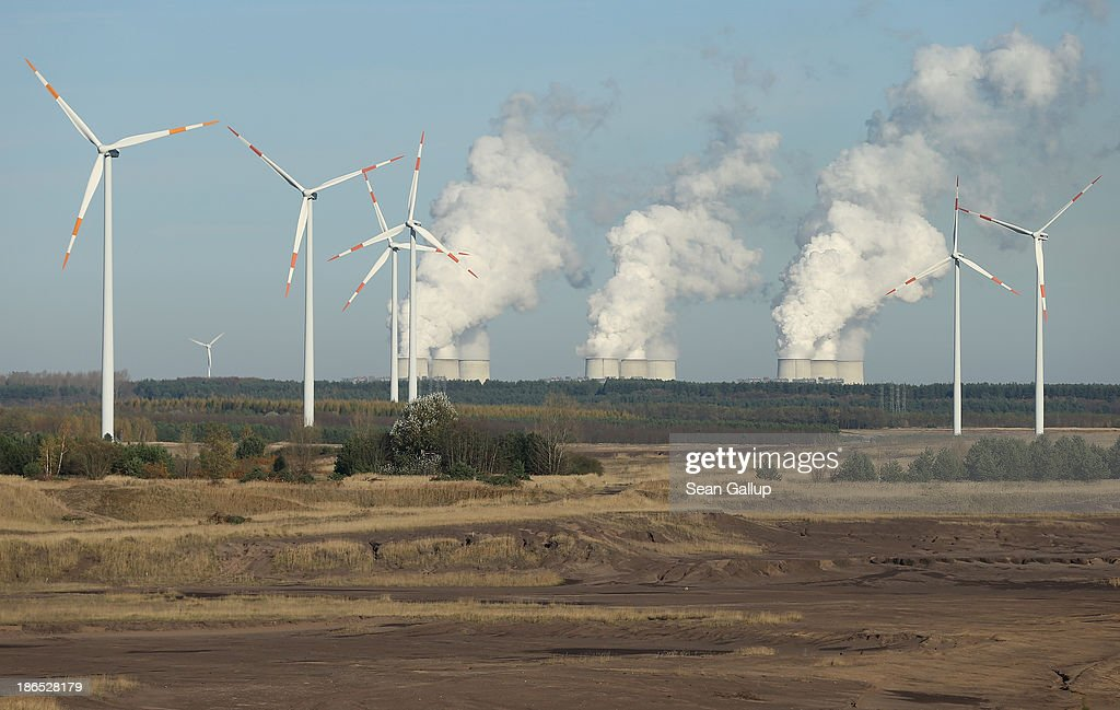 Steam rises from the cooling towers of the Jaenschwalde coal-fired power plant as wind turbines spin on refurbished land where an open-pit coal mine once lay on October 31, 2013 near Jaenschwalde, Germany. The Jaenschwalde plant is fed with lignite coal from nearby open-pit mines, and according to plans by Swedish energy conglomerate Vattenfall and approved by the Brandenburg state legislature, at least five local communities are to be raized and their inhabitants compensated and relocated in order to make way for the expansion of a nearby mine. Energy policy and the role of coal is a heated topic at the moment in coalition negotiations between the Social Democrats (SPD) and Christian Democrats (CDU) currently taking place in Berlin.