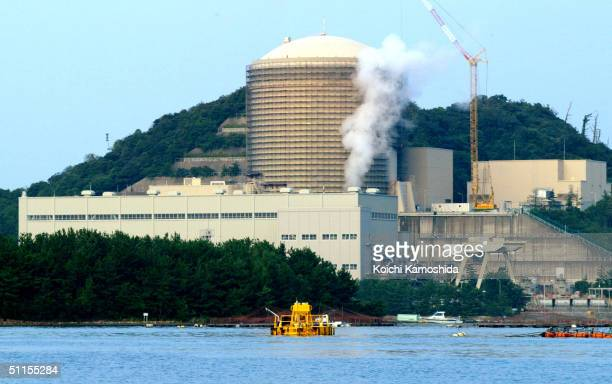 Steam rises from the number 3 reactor of the Mihama Nuclear Plant August 10 2004 in Mihama Japan A steam leak killed four people and injured seven...