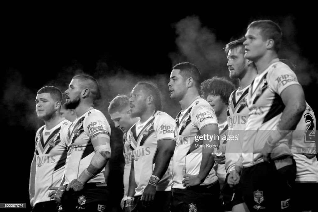 Steam rises off the Titans players as they look dejected after a Titan try during the round 16 NRL match between the Wests Tigers and the Gold Coast Titans at Campbelltown Sports Stadium on June 23, 2017 in Sydney, Australia.