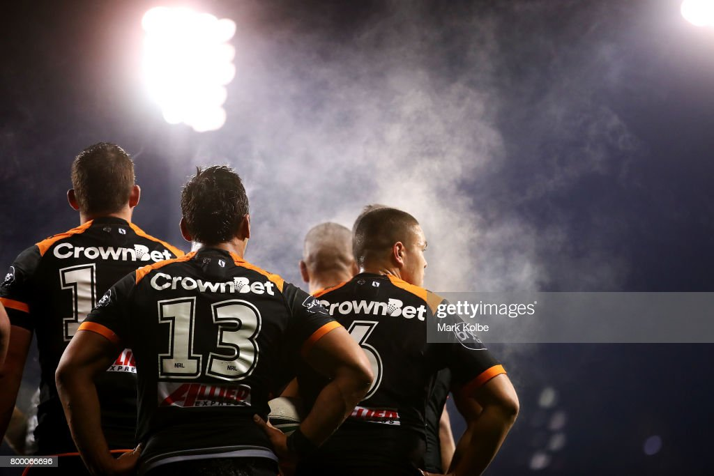 Steam rises off the West Tigers players as they look dejected after a Titan try during the round 16 NRL match between the Wests Tigers and the Gold Coast Titans at Campbelltown Sports Stadium on June 23, 2017 in Sydney, Australia.