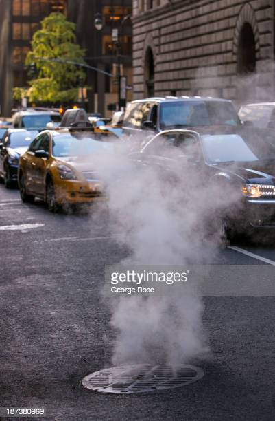Steam rises out of a street manhole near Park Avenue and 44th Street on October 21 2013 in New York City With a full schedule of conventions and...