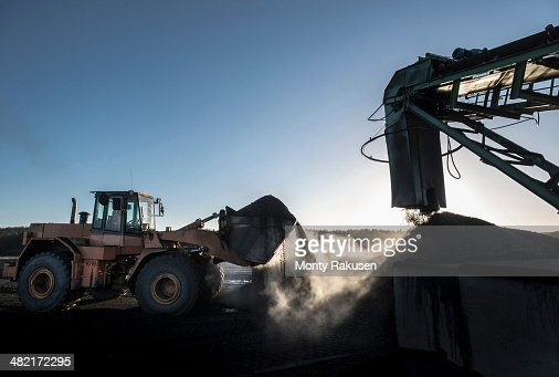 Steam rising from coal in morning light at surface coal mine