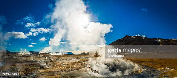 Steam rising from geyser fumarole volcanic lava field panorama Iceland