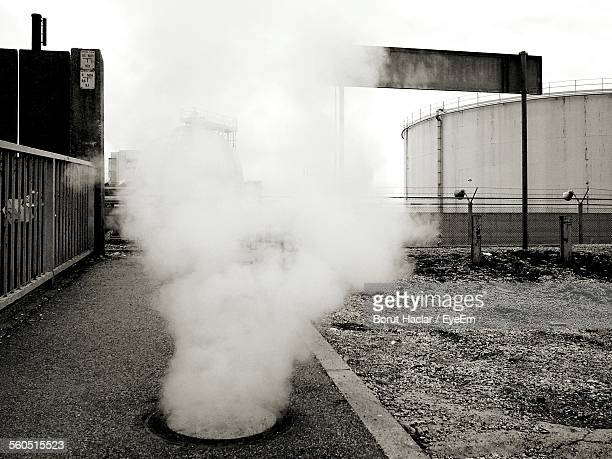 Steam Rising From Manhole Covers In City