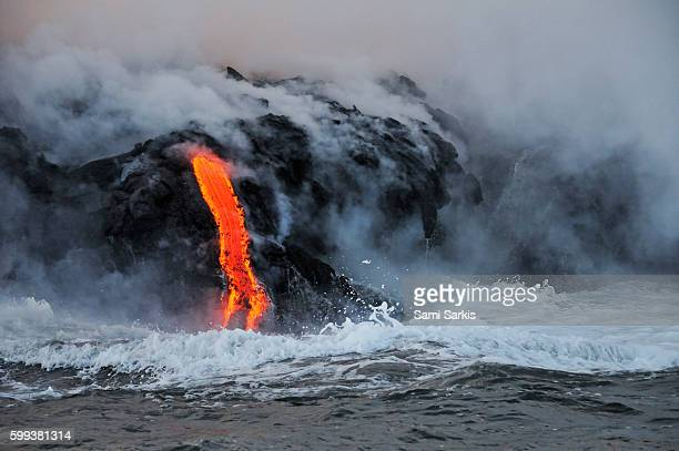 Steam rising off lava flowing into ocean, Kilauea Volcano, Big Island, Hawaii Islands, USA