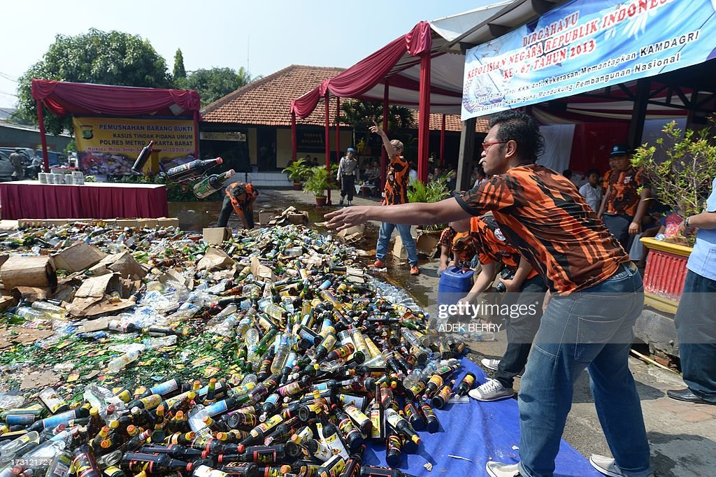A steam roller machine destroys hundreds of alcohol drinks, pornographic and pirated video DVDs in a Jakarta police station on July 8, 2013, seized during recent raids in some areas of the Indonesian capital, as authorities prepare for Ramadan. Islam's holy month of Ramadan is celebrated by Muslims worldwide marked by fasting, abstaining from foods, sex and smoking from dawn to dusk for soul cleansing and strengthening the spiritual bond between them and the Almighty.