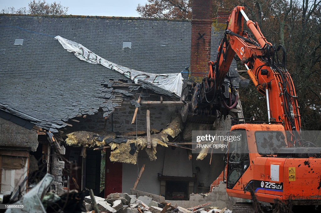 A steam shovel destroys the farm squatted by protestors against a project to build an international airport, following its evacuation, on November 23, 2012 in Notre-Dame-des-Landes, western France. The battle led by opponents against the airport is also judicial, with multiple legal recourses ongoing. The project was signed in 2010 and the international airport is supposed to open in 2017 near the city of Nantes. AFP PHOTO / FRANK PERRY