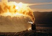 Steam, smoke, sunset