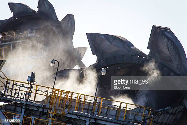 Steam surrounds bucket wheel reclaimers as they operate at the Newcastle Coal Terminal in Newcastle north of Sydney Australia on Friday May 3 2013...