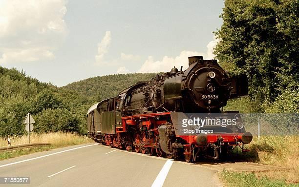 Steam train crossing road