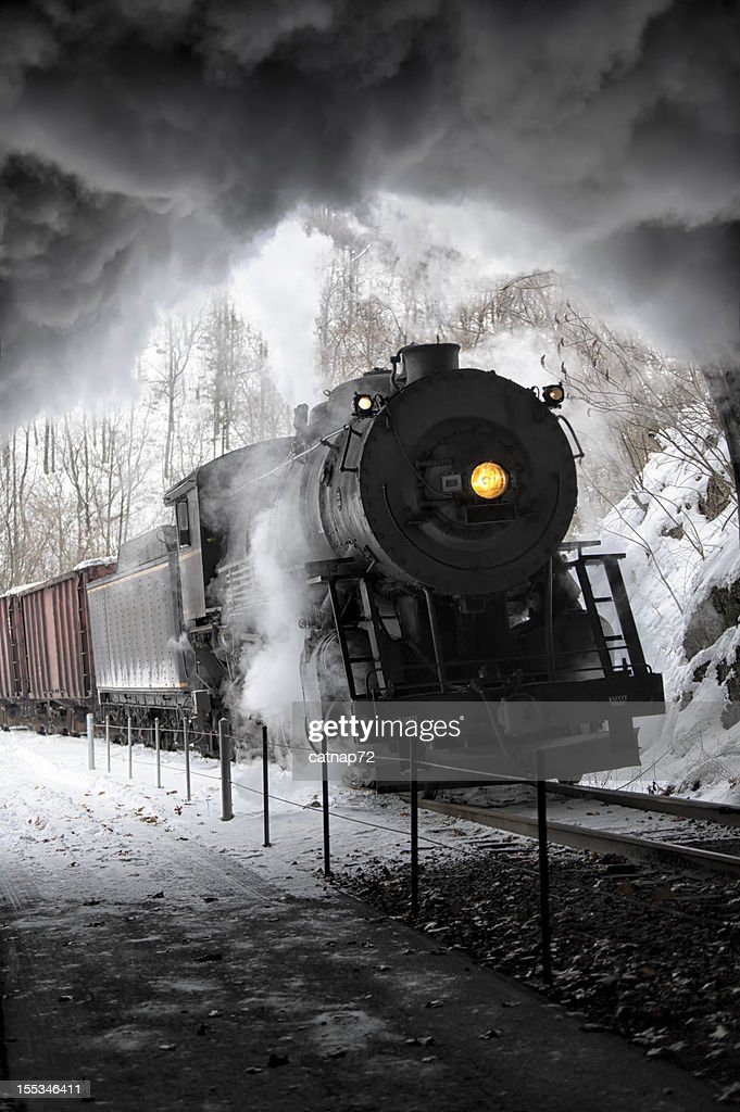 Steam Train Inside Railroad Tunnel, Smoke and Glowing Yellow Headlight