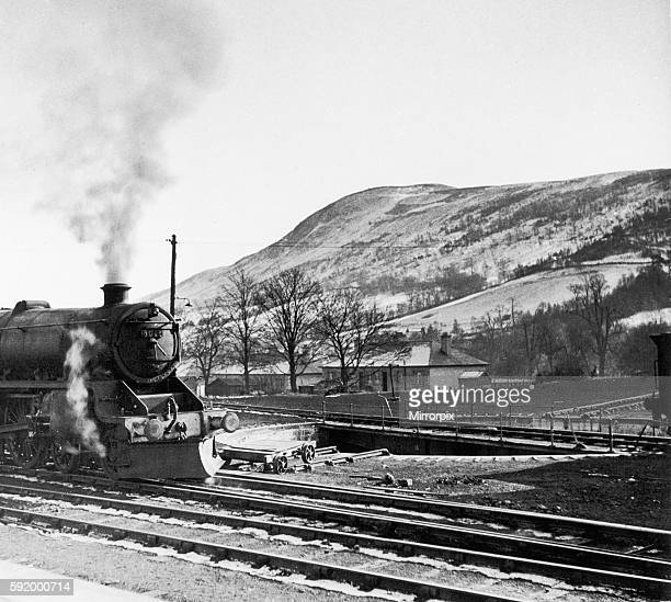 Steam train leaves Blair Atholl on the railway route from Perth northwards to Forres in Morayshire Scotland passing through the Grampian mountain...