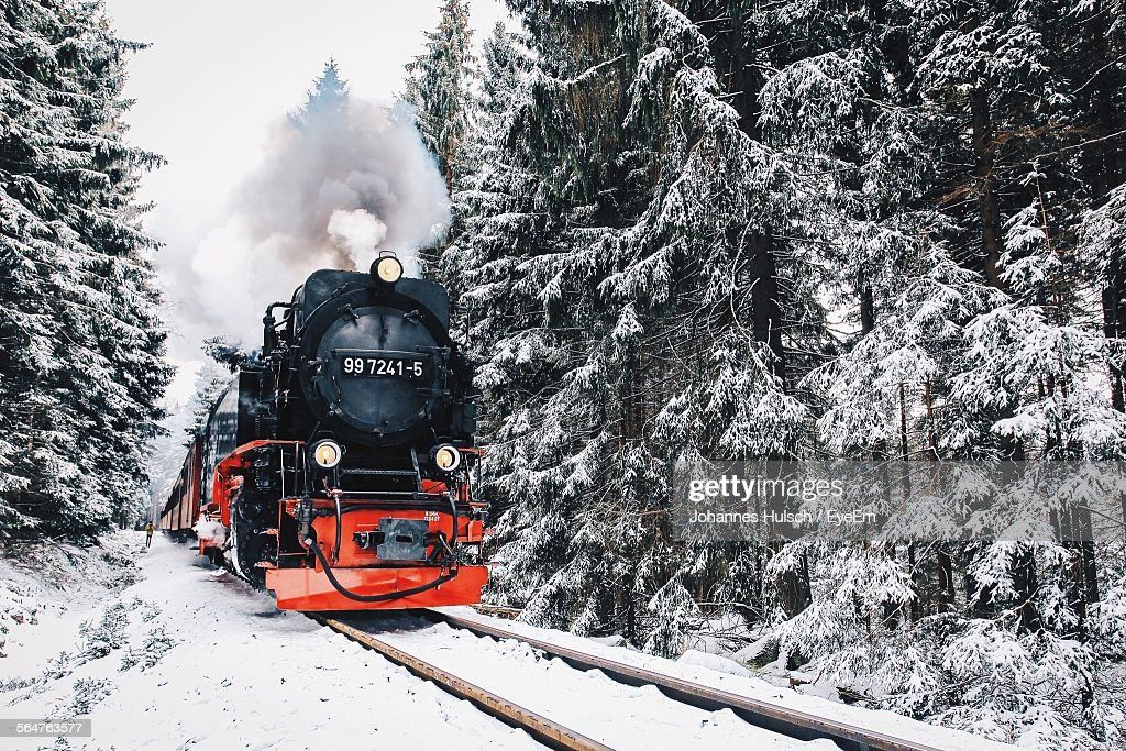 Steam Train On Railroad Track During Winter