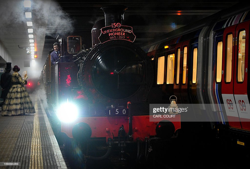 A steam train which carried passengers in the 19th century arrives in Moorgate Underground Station in central London on January 13, 2013, to mark 150 years since the first London underground journey. AFP PHOTO / CARL COURT
