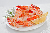 Creative Steamed Shrimps photography for commercial need on white plate on white background with vege props