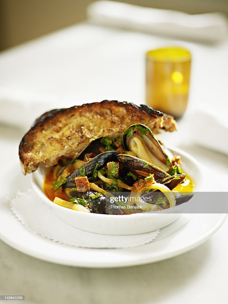 Steamed mussels with andouille sausage : Stock Photo
