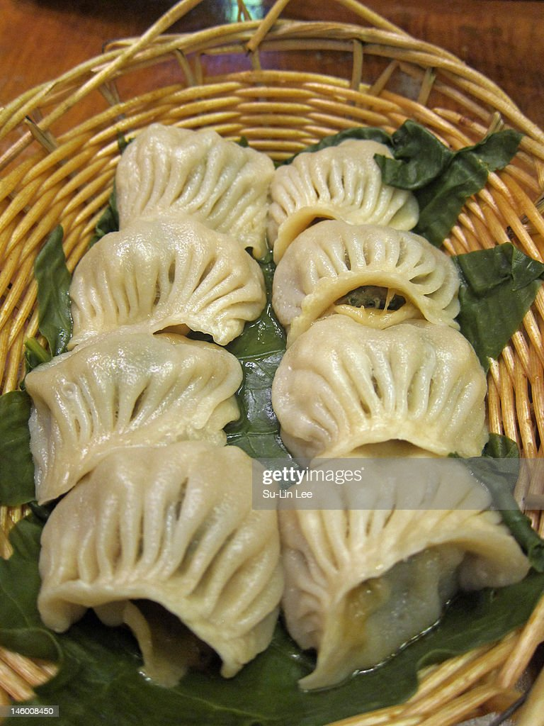 Steamed pork and chive dumplings : Stock Photo