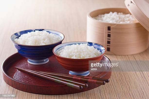 Steamed Rice in Rice Bowls and Wooden Tub