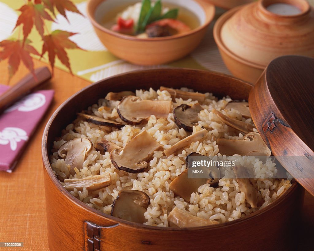 Steamed rice with matsutake mushrooms : Stock Photo