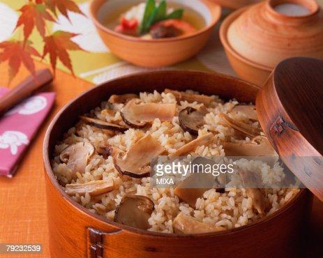 Steamed rice with matsutake mushrooms : Stock Photo