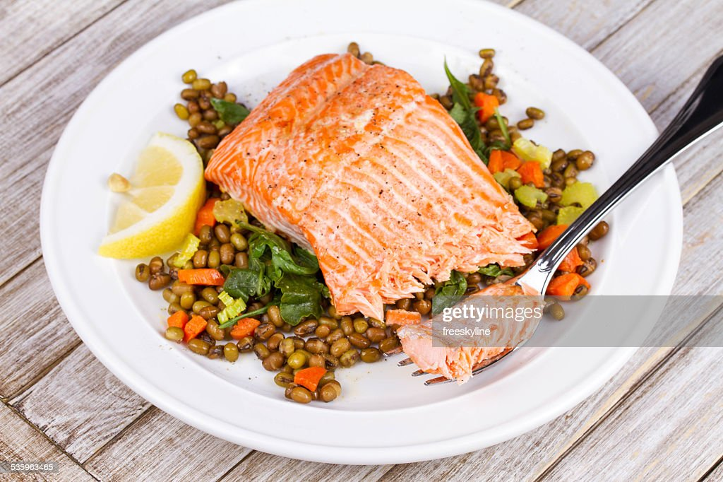 Steamed Salmon with Lentils and Arugula : Stock Photo
