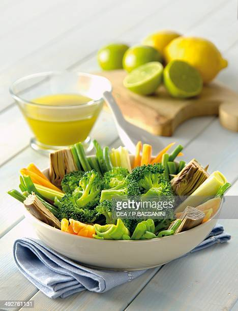 Steamed vegetarian antipasto with broccoli artichokes and spring onions