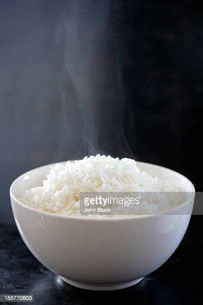 Steaming bowl of cooked rice