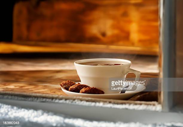 Steaming cup of English Tea with Ginger Snap Cookies