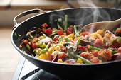 steaming mixed vegetables in the wok, asian style cooking vegetarian and healthy, selected focus, narrow depth of field