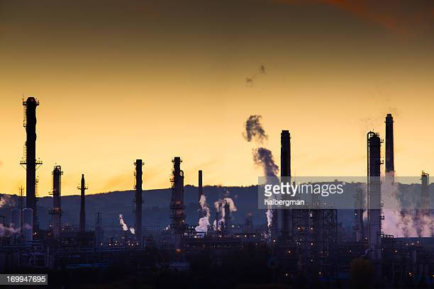 Steaming Oil Refinery at Dusk