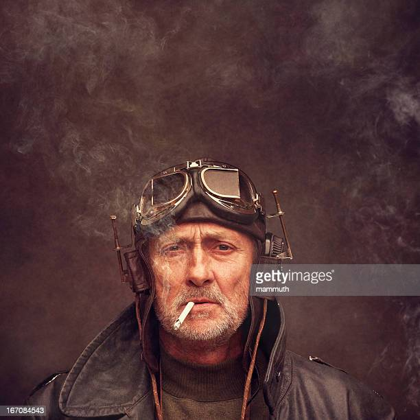 steampunk senior man wearing headphones and goggles