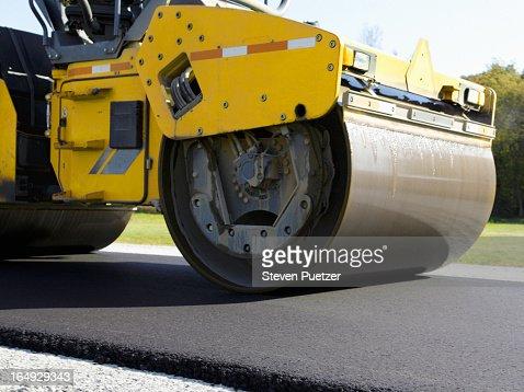 Steamroller rolling asphalt