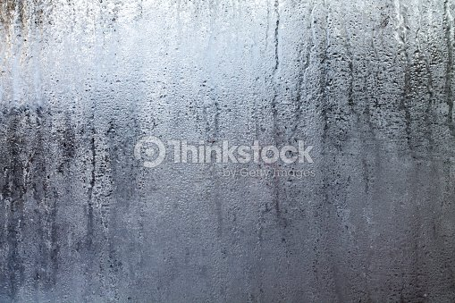 steamy window with water drops stock photo thinkstock