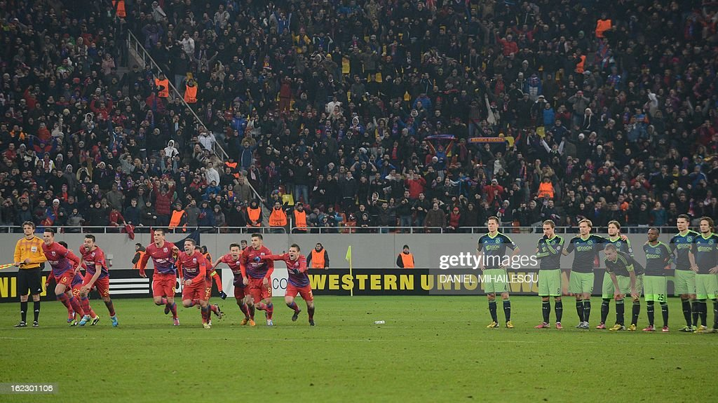 Steaua Bucharest celebrates the qualification against Ajax Amsterdam at the end of penalties kicks during UEFA Europa League Round of 32 football match in Bucharest February 21, 2013.
